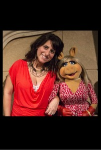 "Zoe Hewitt on the ""Muppets Most Wanted"" set with Miss Piggy for AMC"